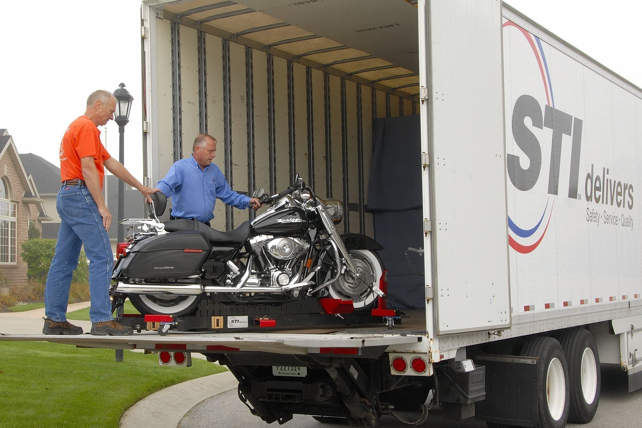 Men loading a motorcycle