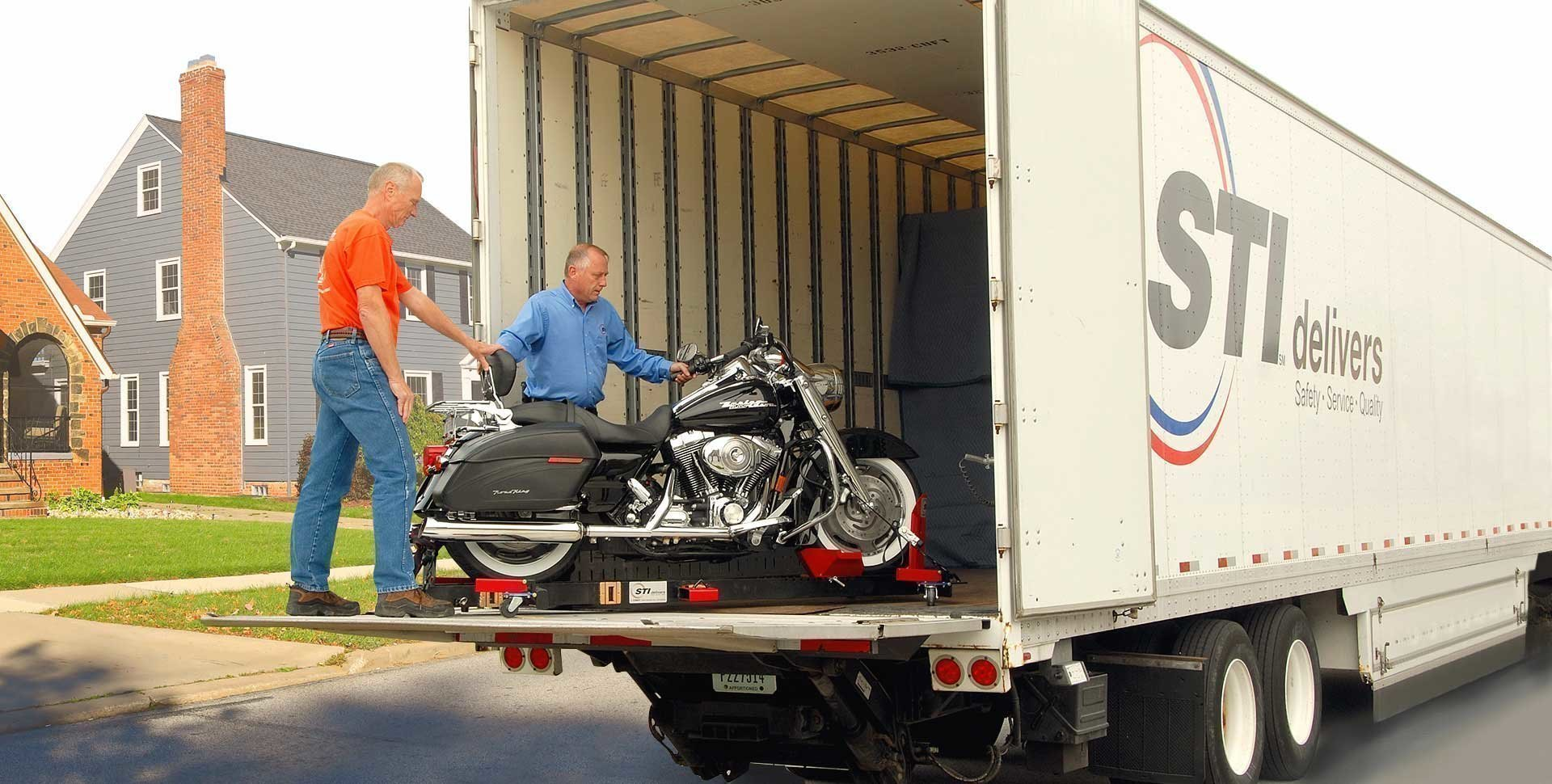 Shipping a motorcycle includes loading on the truck using a specialized lift gate
