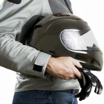Carrying helmet and gloves