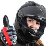 Female rider giving thumbs up