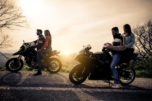 Two Couples on Parked Motorcycles
