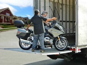 Motorcycle Being Loaded Onto Truck