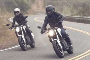 2 People Riding Electric Motorcycles