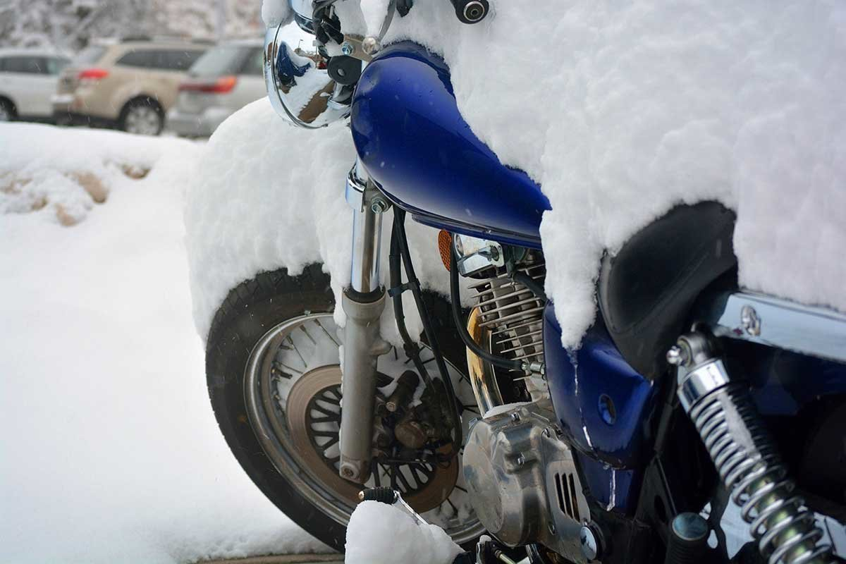 Blue Motorcycle with Snow