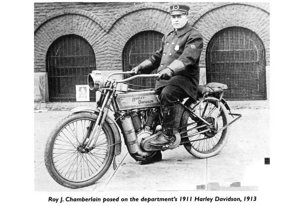 Officer Sitting on 1911 Harley