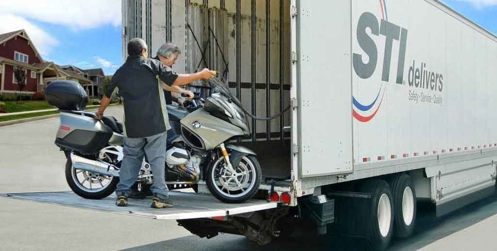 Loading Motorcycle Into Transport Truck