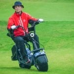 Bill Murray riding a Phat Scooter on the golf course