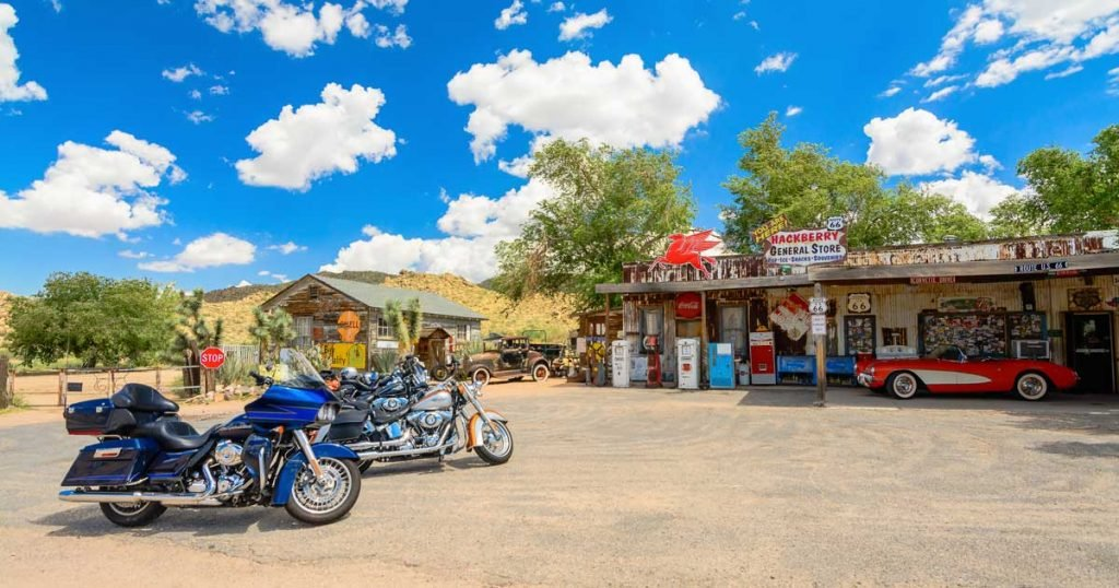 Motorcycles Parked in Front of an Old General Store