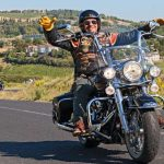 motorcycle rider on highway waving