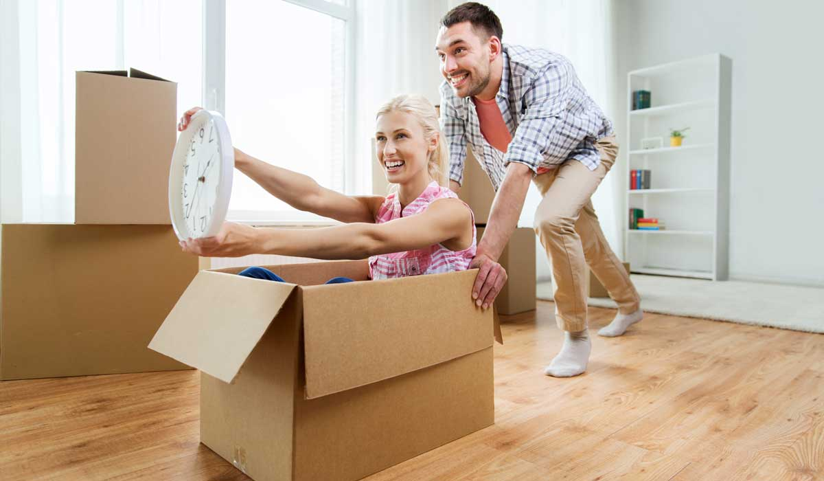 Man and Woman having fun while moving