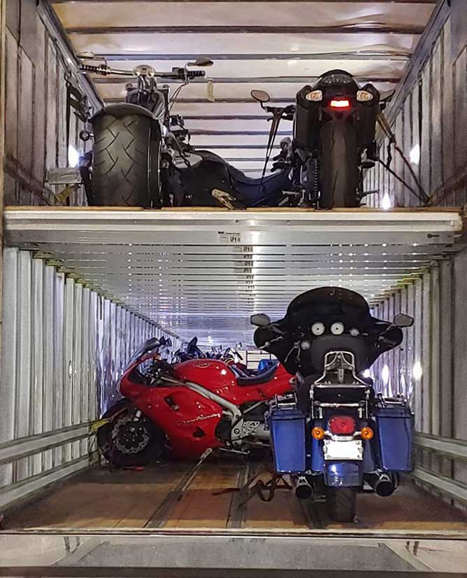 economy motorcycle transport truck stacked