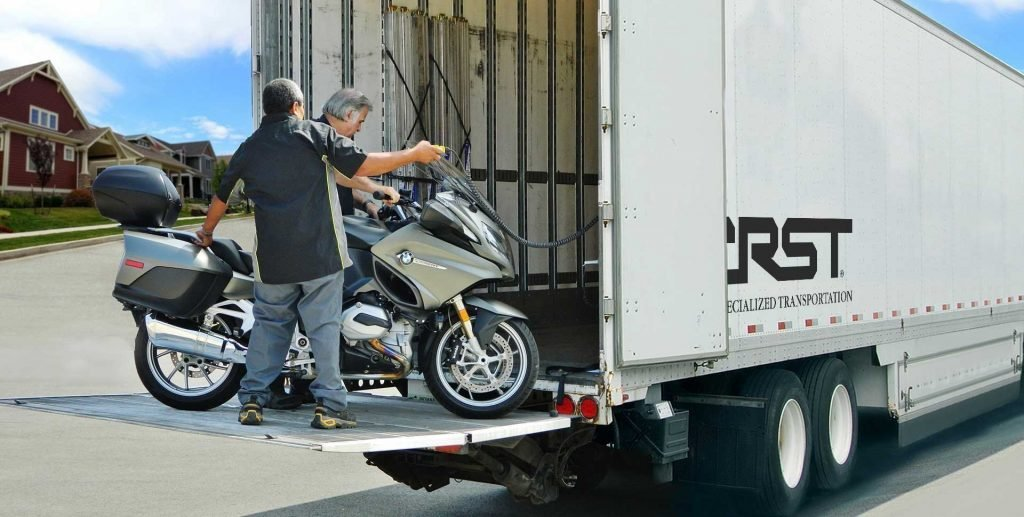 loading bike on a liftgate in a residential neighborhood