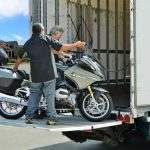 Loading a motorcycle on a liftgate in a residential neighborhood