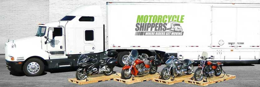 Motorcycles waiting to be loaded in the transport truck