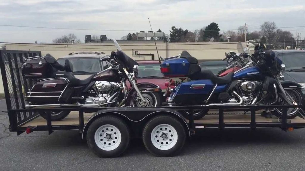 motorcycles loaded on an open trailer
