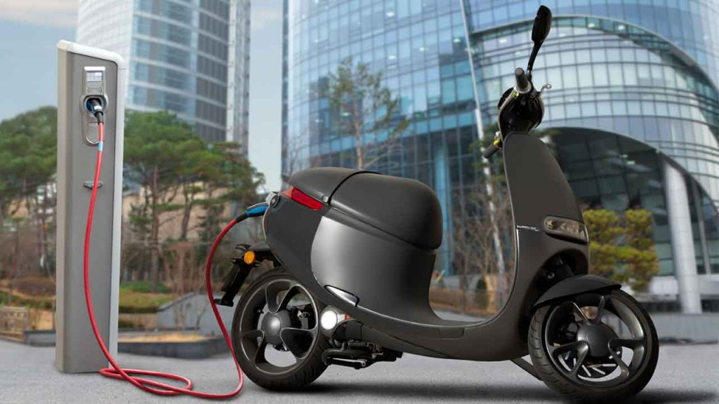 Electric motorbike charging in the city