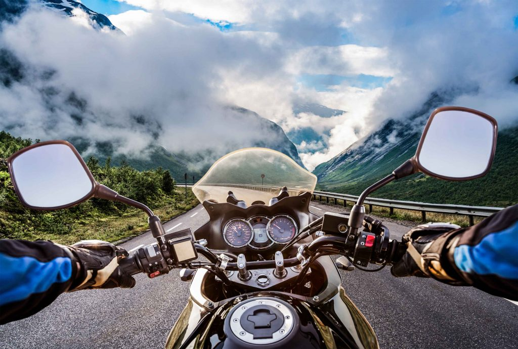 POV of Motorcycle Rider in Snowy Mountains